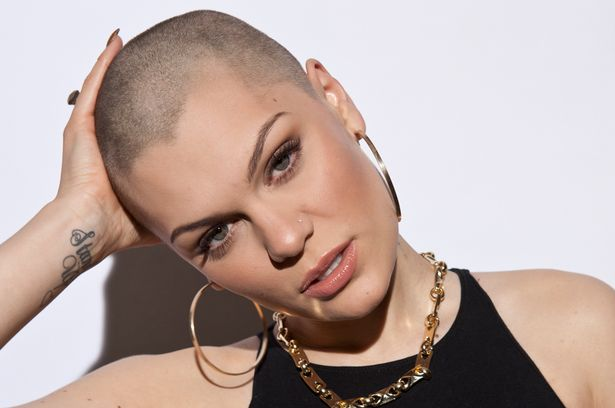 Jessie J wearing a gold chain and hoop earrings