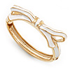 Stylish Snow White Enamel Bow Hinged Bangle Bracelet In Gold Plated Metal - 18cm Length