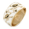 Chunky White Enamel with Skull Motif Hinged Bangle Bracelet In Gold Tone Metal - 20cm L