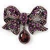 Luxurious CZ Purple Bow Brooch In Gun Metal Finish
