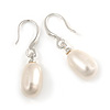 Delicate Oval Freshwater Pearl Earrings In Rhodium Plating - 28mm Long