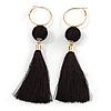 Long Black Cotton Ball and Tassel Hoop Earrings In Gold Tone Metal - 12.5cm L