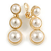 Striking White Faux Pearl Button Drop Clip On Earrings In Gold Plated Metal - 40mm Long