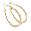 Medium Thick Etched Oval Hoop Earrings In Gold Tone - 55mm L