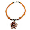 Brown Shell Flower Pendant with Pale Orange Glass Bead Necklace - 38cm L