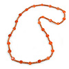 Stylish Orange/ Peach Ceramic/Glass Bead with Gold Tone Metal Rings Long Necklace - 90cm L
