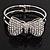 Diamante 'Bow' Hinged Bangle Bracelet In Rhodium Plated Metal - 19cm Length