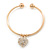 Gold Tone Slip-On Cuff Bracelet With A Crystal Heart Charm - 18cm L