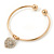 Gold Tone Slip-On Cuff Bracelet With A Crystal Heart Charm - 18cm L - view 3