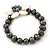 12mm Grey/ White Freshwater Pearl Flex Bracelet With A Mother Of Pearl Central Flower - 17cm L - view 12