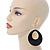 Large Black Enamel Oval Hoop Earrings In Gold Tone - 85mm L - view 2