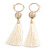 Long Off White Cotton Ball and Tassel Hoop Earrings In Gold Tone Metal - 12.5cm L