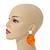 Statement Orange Acrylic Curvy Oval Drop Earrings In Matt Silver Tone - 65mm L - view 2