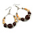 Brown Ceramic/ Natural Wood Bead Hoop Earrings In Silver Tone - 70mm Long