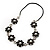 Long Silver/Black Plastic Floral Necklace On Leather Style Cord - 70cm Length - view 2