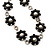 Long Silver/Black Plastic Floral Necklace On Leather Style Cord - 70cm Length - view 3