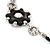 Long Silver/Black Plastic Floral Necklace On Leather Style Cord - 70cm Length - view 5