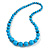 Light Blue/ Teal Graduated Wooden Bead Necklace - 70cm Long (UNEVENLY PAINTED IN PLACES)