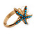 Turquoise Coloured Acrylic Bead 'Starfish' & Simulated Pearl Gold Matte Ring - view 5